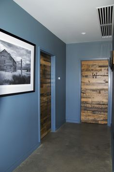 Reclaimed Settlers' Plank for his and hers bathroom doors.