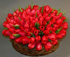 Color Blocking with Red Tulips and Curly willow for added design inside the vase.  www.irisrosin.com