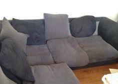 Donne canapé d'angle gris et noir