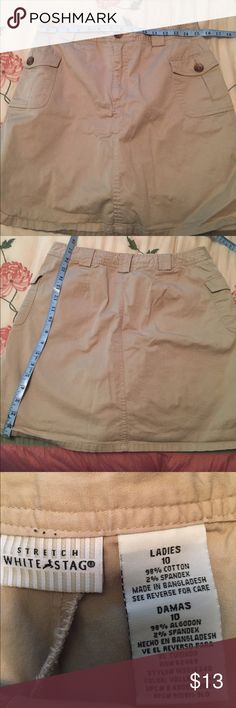 White Stag skort Kahki stretch skort (skirt has shorts attached) Waist measures 32 length is 18 Belt loops and two cargo pockets in front EUC White Stag Skirts