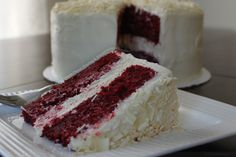 Red Velvet Cheesecake Cake with Cream Cheese Frosting and Shaved White Chocolate.  Admit it - your mouth is watering and you now realize how bad your food porn addiction has become.