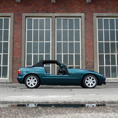 Opening this week's 90s theme: This 1991 BMW Z1 is clad in a marvelous Metallic Primal Green coat of paint and shows off a superb grey leather interior. The modern classic is powered by a 170hp producing 2.5 liter 6-cylinder engine with manual 5-speed transmission. Get close to this fine roadster in stunning condition! Like & subscribe now for more classics! Gray Interior, Leather Interior, Bmw Z1, 90s Theme, 5 Speed Transmission, Bmw Classic Cars, Bmw Models, Green Coat, Rear Brakes