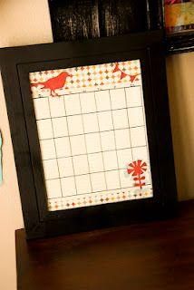 Dry erase calendar, Goodwill frame, spray paint and scrapbook paper.