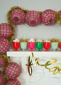 line up a row of colorful goblets on the mantle for a fun take on an advent calendar!