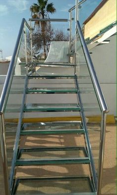 Escalera esterio en cristal y acero inoxidable. Tenerife.