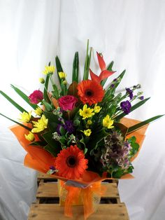 Bold and funky bouquet made with Gerbera's, roses. Created by Florist ilene