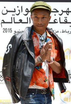 Outlandish style: Pharrell Williams donned a bizarre flat-cap and Hawaiian shirt combo as ...