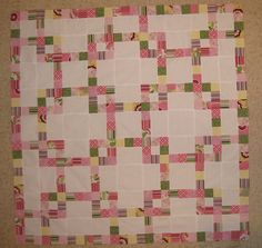 jelly roll quilt  i have a great batik jelly roll of purples, and want to find a nice pattern that is more complex... i like the geometric patterning here