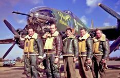 Photographers standing in front of Pappy's Pram, a B-26 Marauder at base, 1943.