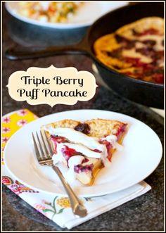 Oven baked triple berry puff pancake with sweet and tart lemon-vanilla yogurt
