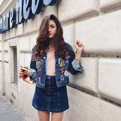 Pin for Later: 17 Ways to Wear Your Denim Skirt  This ain't your average Canadian tuxedo. We love the look of this skirt style paired with an amped-up jean jacket.