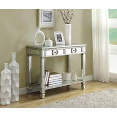 I love this table for the main entrance.  Mirrored 38-inch Sofa Console Table With Two Drawers