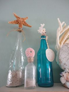 coastal decor DIY project recycled bottles with added sand and seashells for easy DIY beach décor. Blue bottle can be done with mod podge  and food coloring. See  my Mod Podge Board...