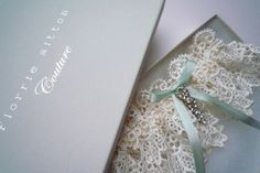 Gorgeous garter with lace, sequins, toile and beads – from Florrie Mitton available at Etsy.