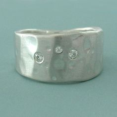 Silver & Moissanite Ring: $80: The stones on this silver band are reminiscent of constellations.