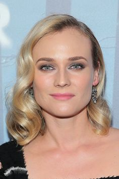 Diane Kruger with old Hollywood waves, silver eyeshadow and pink lips on October 6.