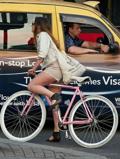 Girl on a pink bicycle (1) by Approaching Beauty, via Flickr