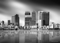 Canary Wharf business district east London. There is located one of the highest buildings in London - One Canada Square that reaches about 235 m.  Shot from the other side of the Thames.  #London #CanaryWharf #BW #blackandwhite #onecanadasquare #canarywharftower #architecture #river #Thames #water #reflection #l4l #likeforlike #followme #photooftheday #UK #Britain #Nikon #Tokina #capital #longexposure_kings #shutup_london #London4All #longexpoelit by richpavphotography
