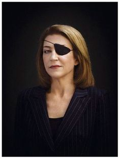 "Sunday Times correspondent Marie Colvin.  Photo by Bryan Adams, 2008, from the  National Portrait Gallery (U.K.).  ""Our mission is to report these horrors of war with accuracy and without prejudice.""—Marie Colvin"