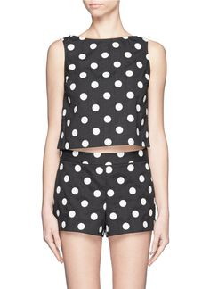 Retro and youthful, this polka dot tank top from alice + olivia is cut with a wide neckline. Wear this piece with a high-waisted flared skirt for a vintage-inspired appeal.