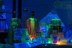 Detail shot of our 2013 Halloween display. Photographed in true light (no editing). Black light and two small LED (one in orange and one in green) spots used. Bottles, jars and papers were hand distressed using coffee, tea, paint, and a baking process.  Photographer: Acid PopTart