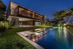 Rear facade of the stunning Indian Creek Residence in Miami Beach Luxury Miami Beach House with Man Made Lagoon Could Be Yours for $29.75M!