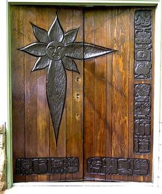 Stylized sun on wood doors