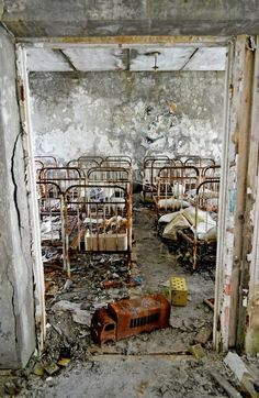 I don't know if it is true, but read somewhere that the picture is made in an abandoned children's hospital after the Tsjernobyl disaster.