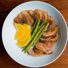 Pekin ducks, also known as crescent or Long Island ducklings, have small breasts. If using magret in this duck a la orange recipe, cook a minute or two longer per side.