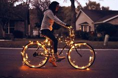 Christmas Light Bike ... It looks cool here but I'm sure if I did it to my bike everyone would think I'm the biggest weirdo on the block! Haha