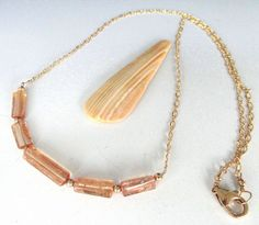 A personal favorite from my Etsy shop https://www.etsy.com/listing/519407292/imperial-topaz-14kt-gold-filled-necklace