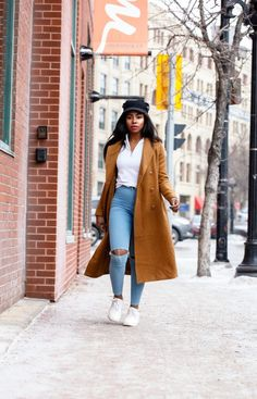 How o style camel coats for simple and chic Winter to Spring Transition weather. Pairing your most comfortable everyday pieces such as white runners, high waisted denim and white tees!