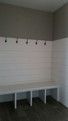 www.ruconhomes.com Locker room,  Ship - lap mudroom Great back entry with lots of hooks, space to put shoes or baskets. Sherwin Williams #7017 Dorian Gray wall color.  Sherwin Williams #7636 Origami woodwork.