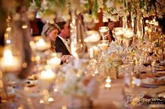 White gold wedding reception with abundance of floating candles