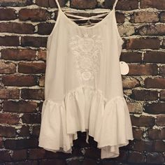 Angel Tank This light weight flowy  tank has beautiful embroidery detailing on the front and lace-up tie in the back. Available in Small and Large. If you don't see a listing in your size please ask me to create a listing for you. Tops Tank Tops