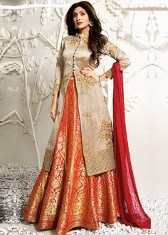 Be an angel and create and establish a smashing influence on everyone by wearing this Shilpa Shetty beige and orange jacquard, raw silk and viscose long choli lehenga. The lovely embroidered, resham a. Lehenga Choli Designs, Kurta Designs, Long Choli Lehenga, Lehnga Dress, Kurti Designs Party Wear, Anarkali Lehenga, Lehenga Suit, Silk Lehenga, Design Of Kurti