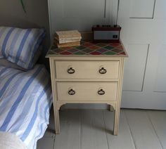 A pretty two drawer bedside cabinet, with upstand and bale handles. This pretty two drawer bedside cabinet has been painted in Annie Sloan 'Country Grey' with two coats of Annie Sloan soft wax.