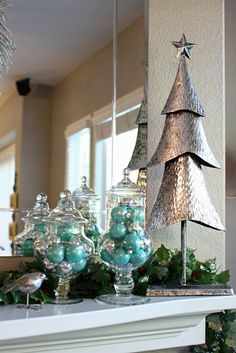 Sunny Side Up: Aqua and Silver Christmas Mantel Decor. A modern take on the traditional classics, for more decor tips visit www.sunnysideup.com