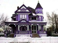 Stunning purple Victorian home.  Such vibrant colors!