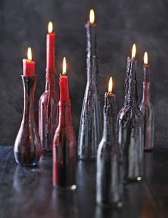 All you need is some materials like: empty bottles of different sizes, gloss enamel paint in various dark colors, acrylic paint with glitter in various dark colors, and red and black candles.{