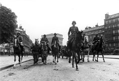 JUN  14 1940 The Germans enter Paris – Americans diplomats remain - See more at: http://ww2today.com/German troops on the the streets of Paris. Two million Parisians had fled but the city was spared a military assault.