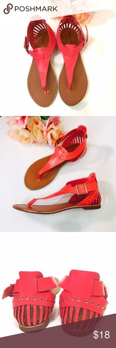Hot coral pink t-strap sandals Vibrant coral t-strap sandals with gold outline all around the shoe. Cute vertical cut out design in the back heel area. Two small scuff marks, see 4th pic, but other than that it's in excellent very gently used condition with clean interior. Size 7.5. ❌trade bundle discount ✍make an offer❣ Breckelles Shoes Sandals
