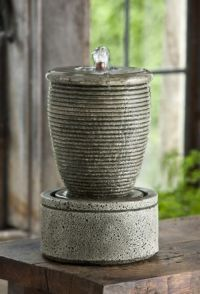 www.diy-gardensupplies.com  The ribbed style on the urn serves to give the flowing water texture and make it shimmer in the sunlight. Incredibly sturdy, this fountain is constructed from cast stone, and the electric pump constantly pumps water through the center of the fountain, causing it to overflow down the ribbed sides. A recirculating fountain, this is a convenient accent to your outdoors.