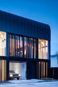 ODOS Architects Design Three Connecting Homes Covered In Black Zinc