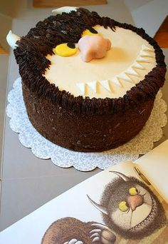 Step by step instructions on how to create this cake.----I used the cake recipe and both the vanilla and chocolate buttercream recipes and it tasted wonderful! The decorating of it turned out very well also.