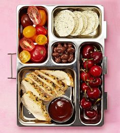 Stretch supper into the next day with leftover chicken with BBQ sauce, grape tomatoes, rice crackers, chocolate-covered raisins, and cherries.
