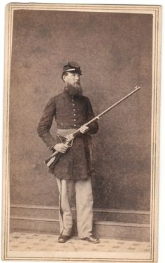 """This CDV was taken in 1861 or early 1862 and shows 1st Sergeant Henry Kinsman, Company F (Vermont) 1st USSS with his personal target rifle. You can see it's a half-stock slant breech Sharps sporting rifle with a tang sight mounted on the wrist. Aside from Truman Head's (""""California Joe"""", Co. C 1st USSS) military Sharps rifle purchased while in Washington, this is the only other one I've seen show up so early."""