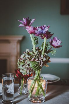 thick-stemmed floral centerpieces, photo by Amber Gress http://ruffledblog.com/long-island-city-wedding #flowers