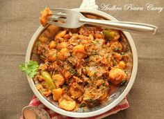 Andhra Prawns Curry Recipe: A spicy South Indian Prawns curry. Read on for a recipe wih step by step pics.