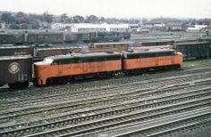 New Haven Railroad DER-2a ALCO FA-1 locomotives # 0405 & # 0427, (wearing the original orange & green with silver pin stripe scheme) are seen leading a manifest freight train in a yard at an unknown location during the late 1940's, Mac Seabree Collection